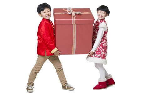 Happy children carrying a large Chinese new year gift