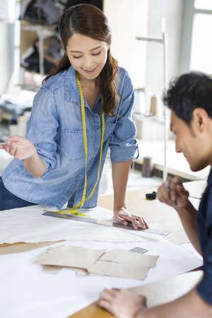 Two fashion designers working in studio