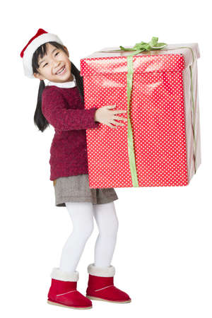 Happy girl and Christmas gift LANG_EVOIMAGES