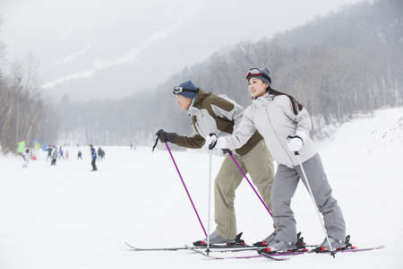 Young couple skiing in ski resort LANG_EVOIMAGES
