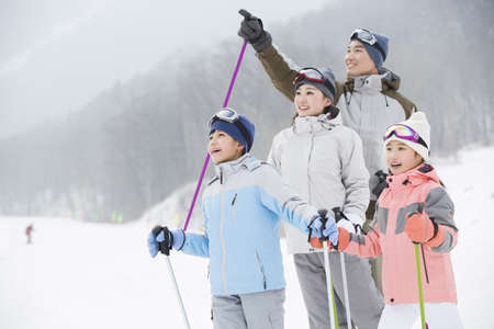 incidental people: Young family skiing in ski resort