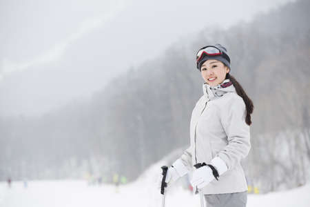 Portrait of young female skier
