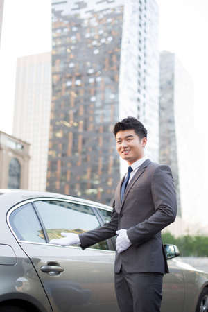 designated: Chauffeur greeting next to the car