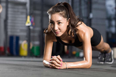 Young woman doing plank exercise
