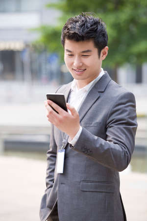 cardkey: Young businessman using smart phone