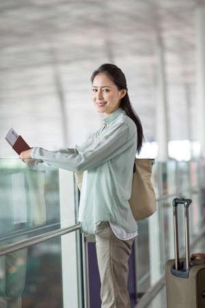 Mature woman waiting at airport