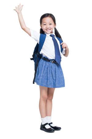 Happy schoolgirl waving LANG_EVOIMAGES