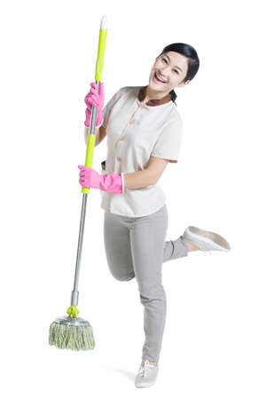 cleaning service: Cleaner holding a mop