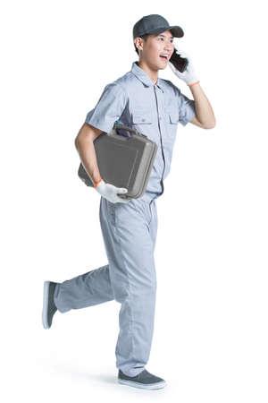 Repairman talking on the phone LANG_EVOIMAGES