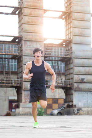 well made: Young jogger running outdoors LANG_EVOIMAGES
