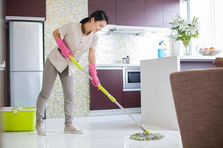cleaning service: Domestic staff cleaning kitchen