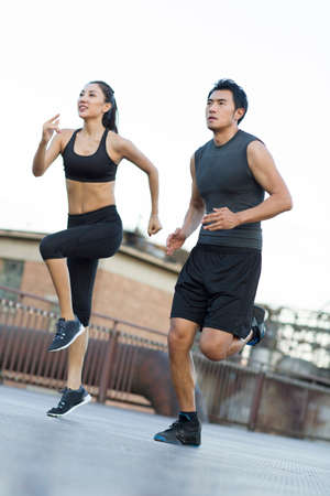 Young joggers running outdoors LANG_EVOIMAGES