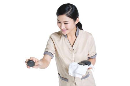 lastone therapy: Massage therapist doing hot stone massage