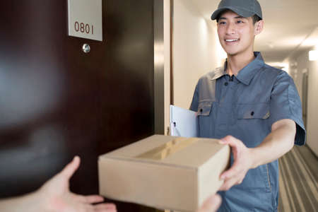 cardboard only: Delivery person holding package