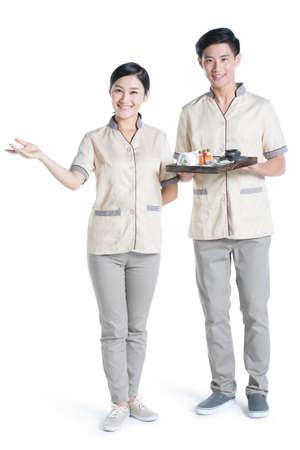 lastone therapy: Massage therapists holding massage supplies