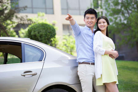 transportation: Happy young couple and car