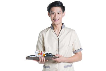 lastone therapy: Massage therapist holding massage supplies