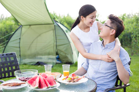 Young couple picnicking outdoors