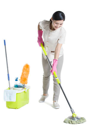 Cleaner holding a mop