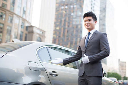 transportation: Chauffeur greeting next to the car