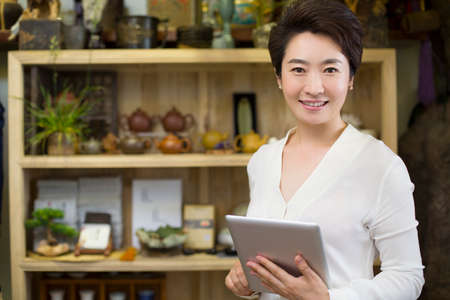 shopkeeper: Shopkeeper with digital tablet