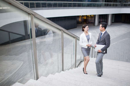 staircases: Business person talking on the stairs