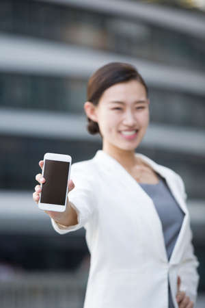 touchscreen: Businesswoman showing smart phone