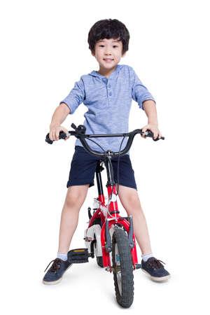 Happy boy riding bike LANG_EVOIMAGES