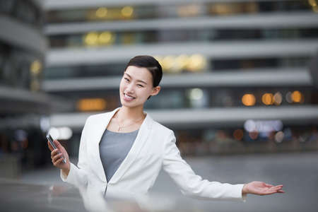 Businesswoman making a welcome gesture
