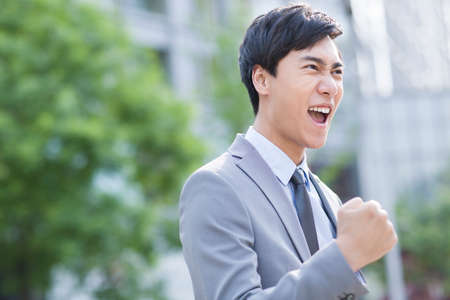 cheer full: Young businessman cheering