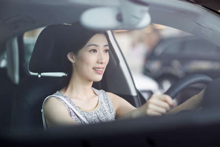 drivers seat: Young woman taking a test drive