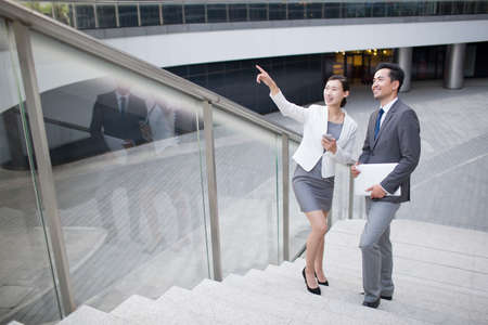 staircases: Business person pointing and looking at view