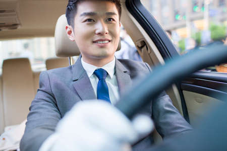drivers seat: Chauffeur driving car LANG_EVOIMAGES