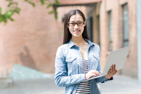 Young woman holding a laptop