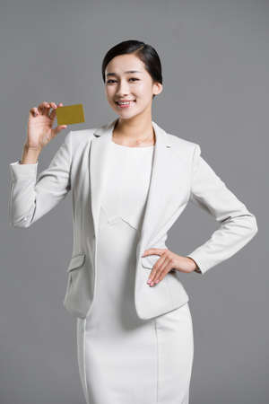 one adult only: Happy young businesswoman holding a credit card
