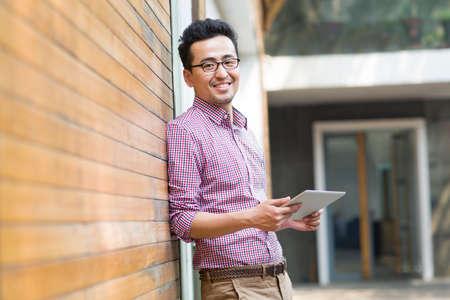 Man holding a digital tablet