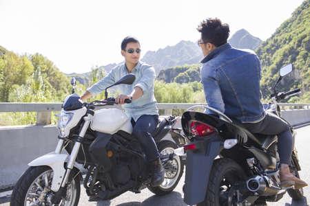 close range: Young Chinese men riding motorcycle
