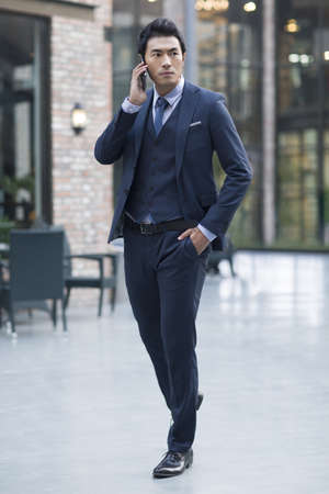 move in: Confident businessman talking on the phone