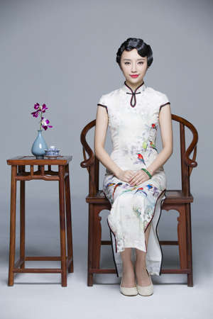 Portrait of young beautiful woman in traditional cheongsam LANG_EVOIMAGES