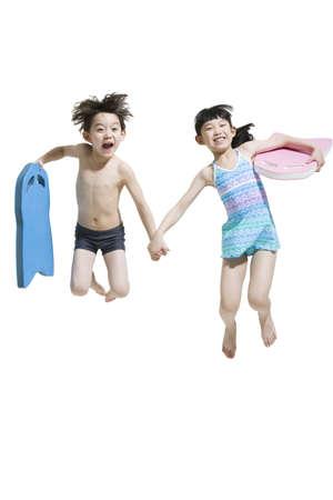 two piece swimsuit: Cute children in swimsuit with kickboards