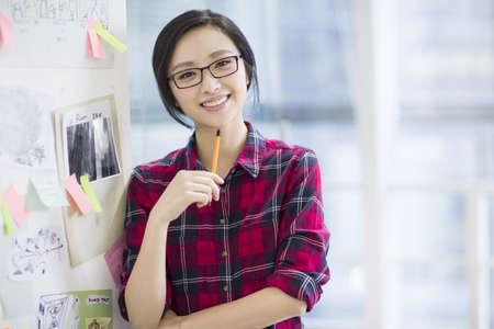 Female designer working in office LANG_EVOIMAGES