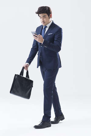 one man only: Young businessman using smart phone