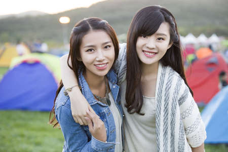 Happy young Chinese women LANG_EVOIMAGES