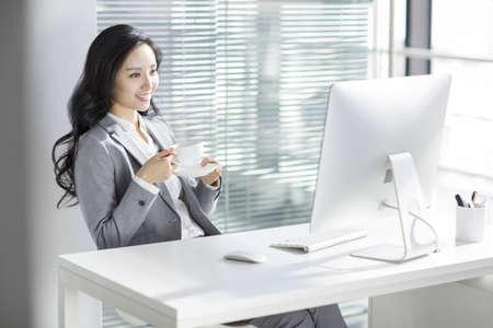 Businesswoman taking a coffee break