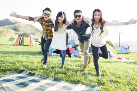 looking away from camera: Happy Chinese friends at music festival