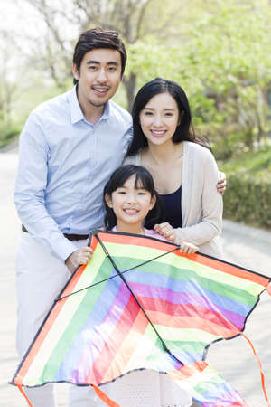 family: Happy young family with a kite