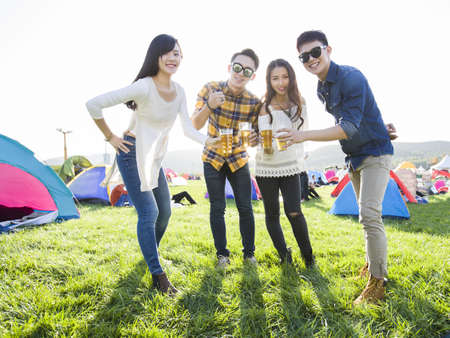 Happy Chinese friends at music festival