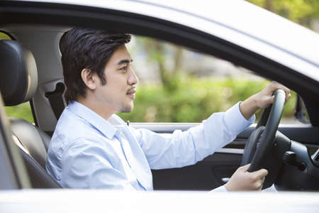 transportation: Young man driving car LANG_EVOIMAGES