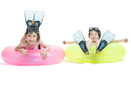 two piece swimsuit: Cute children in swimsuit with swim rings