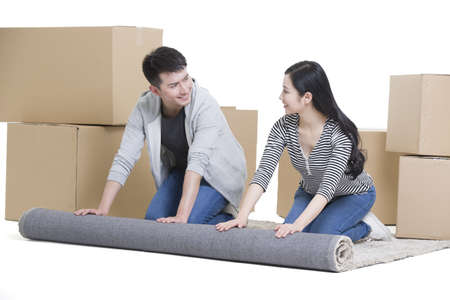 oriental rug: Young couple moving to a new house